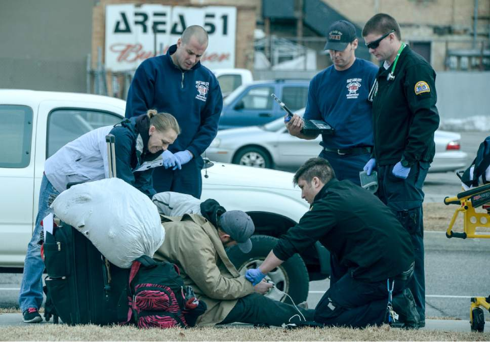 Francisco Kjolseth | Tribune file photo Paramedics attend to a homeless man in Salt Lake City on Tuesday. A recent poll story on homelessness tries to answer the questions surrounding funding and responsibility.