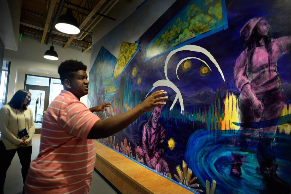 Scott Sommerdorf   |  The Salt Lake Tribune   Homeless youth Phillip Gant shows the mural that he and other homeless youth helped paint as he led a tour of The Volunteers of America youth shelter, Thursday, November 17, 2016. Gant explained how key the shelter has been for him since he came to Utah from the Forth Worth, Texas area.
