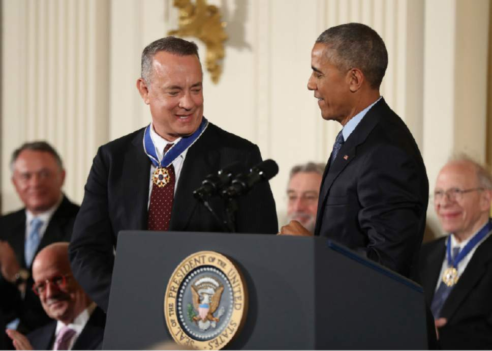 President Barack Obama presents the Presidential Medal of Freedom to actor Tom Hanks during a ceremony in the East Room of the White House Tuesday, Nov. 22, 2016, in Washington.  (AP Photo/Manuel Balce Ceneta)