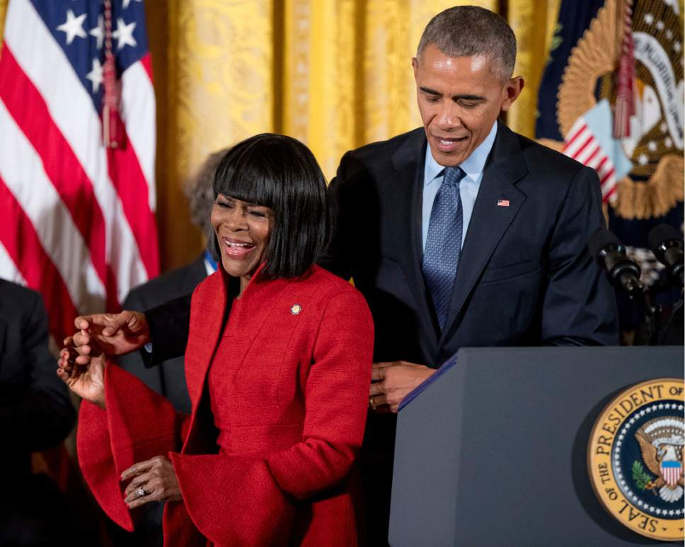 President Barack Obama stands with actress Cicely Tyson, left, before presenting her with the Presidential Medal of Freedom during a ceremony in the East Room of the White House, Tuesday, Nov. 22, 2016, in Washington. Obama is recognizing 21 Americans with the nation's highest civilian award, including giants of the entertainment industry, sports legends, activists and innovators. (AP Photo/Andrew Harnik)