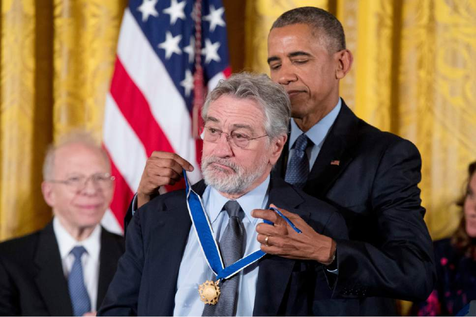 President Barack Obama presents the Presidential Medal of Freedom to Actor Robert De Niro during a ceremony in the East Room of the White House, Tuesday, Nov. 22, 2016, in Washington. Obama is recognizing 21 Americans with the nation's highest civilian award, including giants of the entertainment industry, sports legends, activists and innovators. (AP Photo/Andrew Harnik)