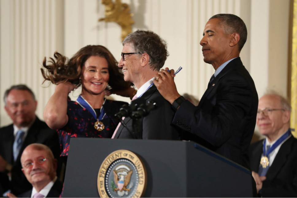 President Barack Obama presents the Presidential Medal of Freedom to Bill and Melinda Gates during a ceremony in the East Room of the White House Tuesday, Nov. 22, 2016, in Washington. Obama is recognizing 21 Americans with the nation's highest civilian award, including giants of the entertainment industry, sports legends, activists and innovators. (AP Photo/Manuel Balce Ceneta)
