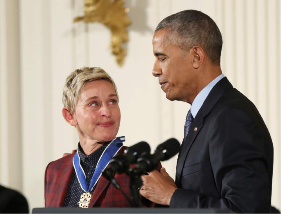 Actress, comedian, and talk show host Ellen DeGeneres, glances at President Barack Obama as she is presented the Presidential Medal of Freedom during a ceremony in the East Room of the White House Tuesday, Nov. 22, 2016, in Washington. Obama is recognizing 21 Americans with the nation's highest civilian award, including giants of the entertainment industry, sports legends, activists and innovators. (AP Photo/Manuel Balce Ceneta)