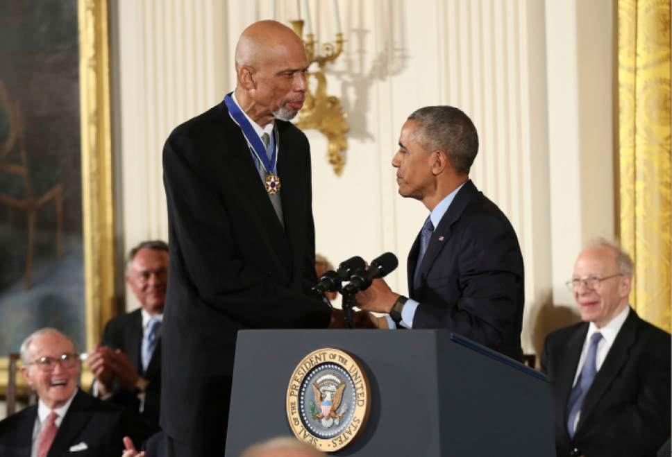 President Barack Obama presents the Presidential Medal of Freedom to former NBA basketball player Kareem Abdul Jabbar during a ceremony in the East Room of the White House Tuesday, Nov. 22, 2016, in Washington.  (AP Photo/Manuel Balce Ceneta)