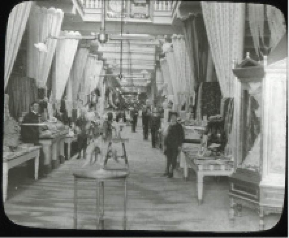 An interior view of ZCMI in Salt Lake City. Because of a piece of art hanging near the top of the photo, this is likely from the late 1870s or early 1880s.