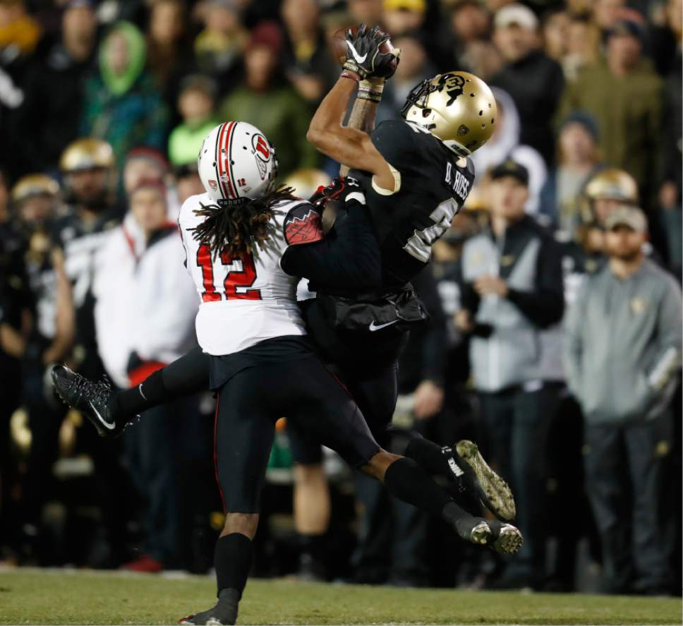 Colorado wide receiver Devin Ross, right, pulls in a pass over Utah defensive back Justin Thomas in the first half of an NCAA college football game Saturday, Nov. 26, 2016, in Boulder, Colo. (AP Photo/David Zalubowski)