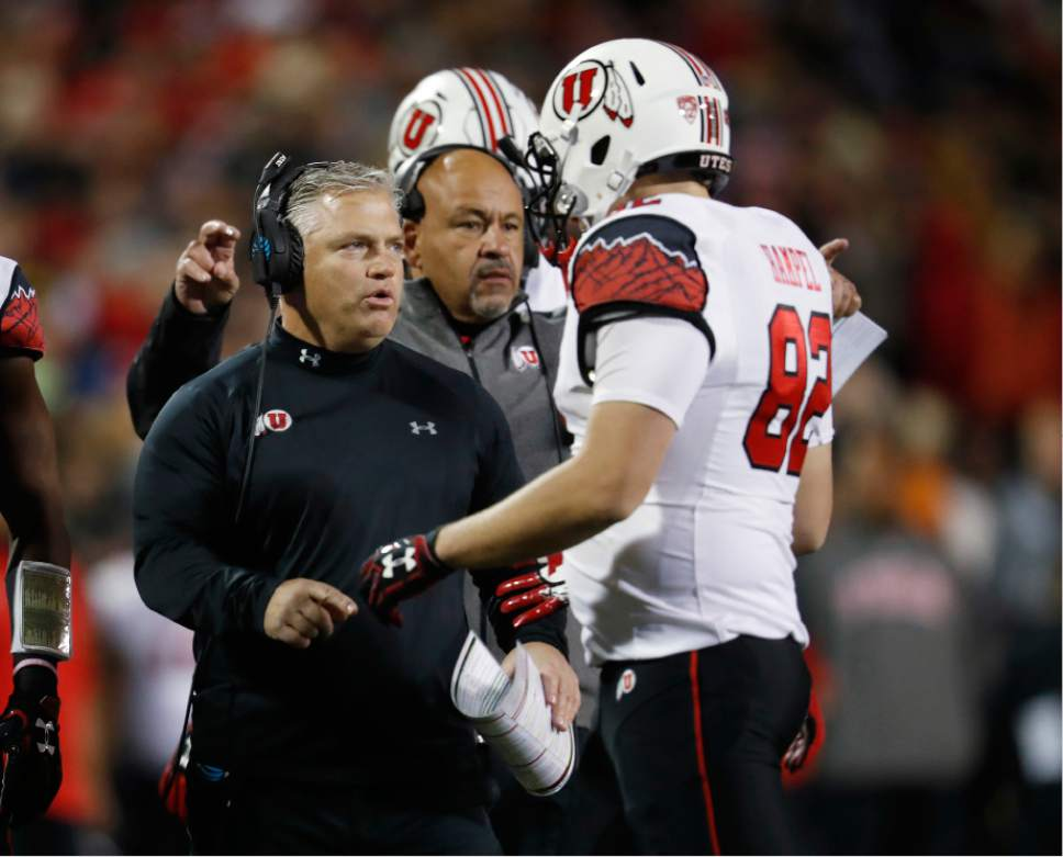 Utah head coach Kyle Whittingham, left, confers with tight end Ken Hampel in the first half of an NCAA college football game against Colorado, Saturday, Nov. 26, 2016, in Boulder, Colo. (AP Photo/David Zalubowski)