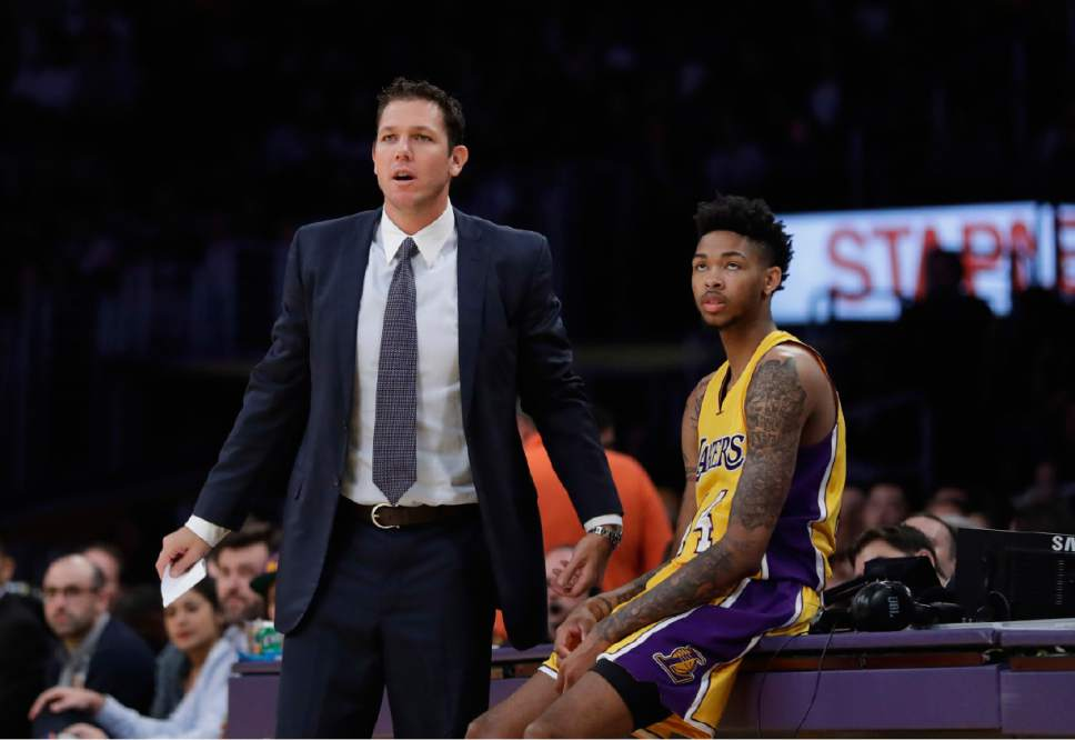 Los Angeles Lakers head coach Luke Walton, left, and Brandon Ingram watch action during the first half of an NBA preseason basketball game against the Denver Nuggets, Friday, Oct. 7, 2016, in Los Angeles. (AP Photo/Jae C. Hong)