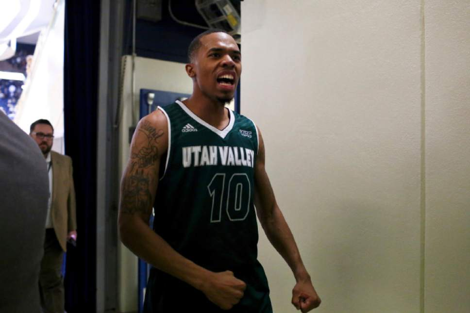Utah Valley guard Jordan Poydras (10) celebrates after the team's NCAA college basketball game  against BYU on Saturday, Nov. 26, 2016, in Provo, Utah. Utah Valley won 114-101. (Sammy Jo Hester/The Daily Herald via AP)