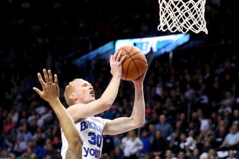 BYU  guard TJ Haws (30) goes up for a basket against Utah Valley during an NCAA college basketball game Saturday, Nov. 26, 2016, in Provo, Utah. Utah Valley won 114-101. (Sammy Jo Hester/The Daily Herald via AP)