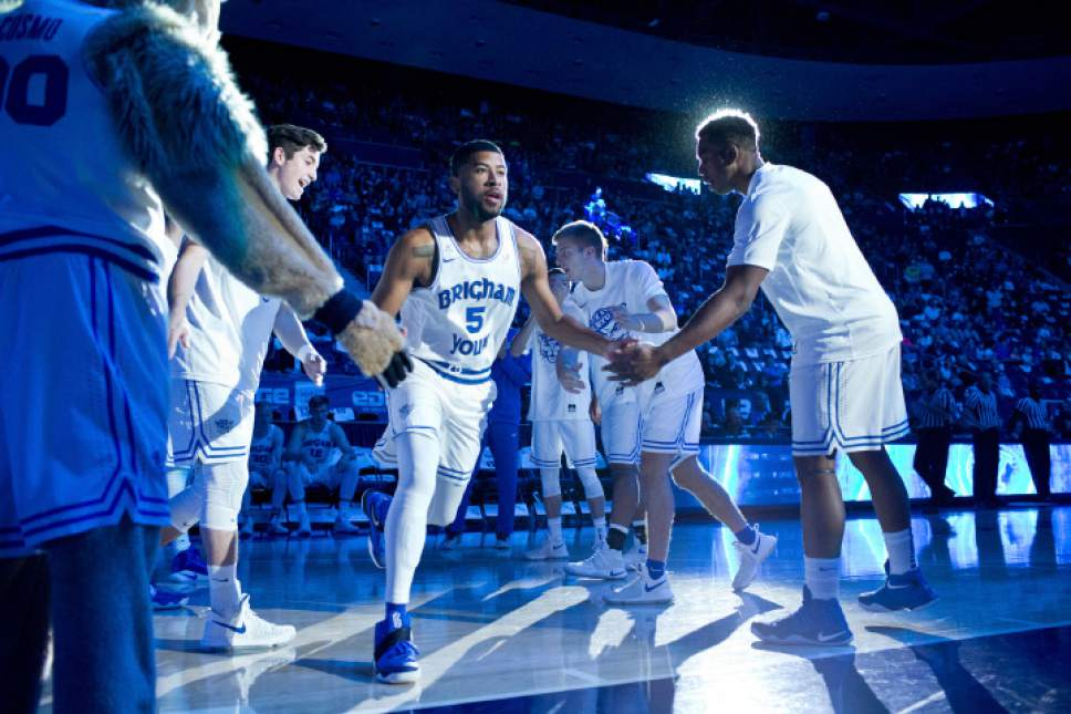 BYU guard L.J. Rose (5) runs onto the court before the team's NCAA college basketball game against Utah Valley on Saturday, Nov. 26, 2016, in Provo, Utah. (Sammy Jo Hester/The Daily Herald via AP)