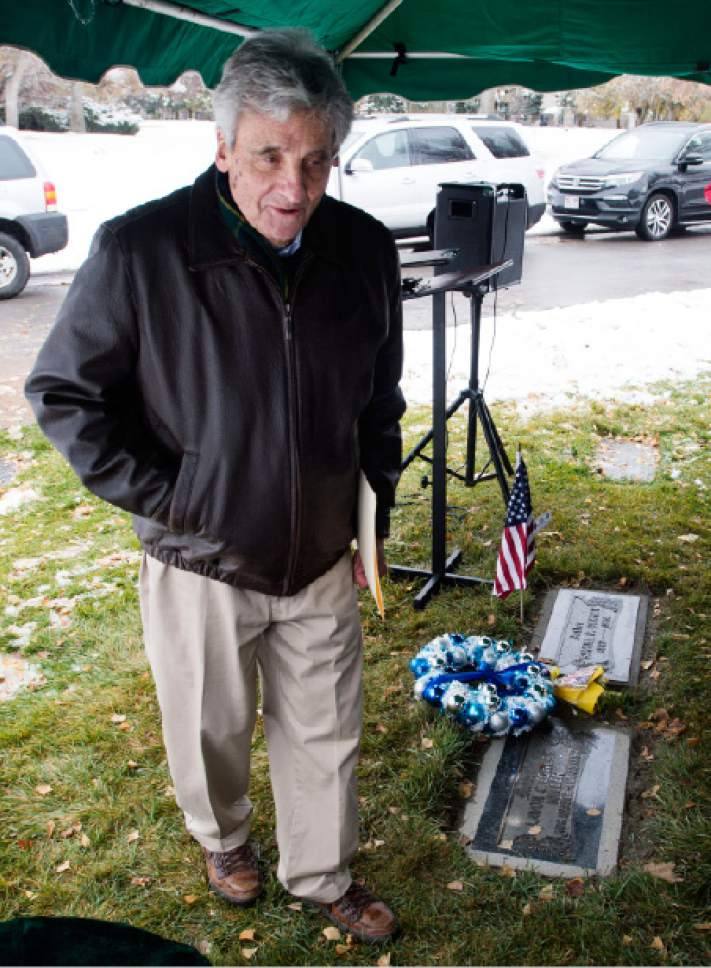 Steve Griffin / The Salt Lake Tribune   At the graveside of his parents, Lavon and Samuel Cowley, Sam Cowley places a flag at his father's gravesite after speaking about his father's life and eventual death as Special Agent for the FBI as the Utah Chapter of the Society of Former Special Agents of the FBI holds a memorial service for Cowley, who died Nov. 28, 1934, from wounds suffered in a gun battle with notorious bank robber Lester Gillis, known as Baby Face Nelson. Cowley was born in Idaho and received a degree from the Utah Agricultural College in Logan. Service was held at the Wasatch Lawn Memorial Park in Salt Lake City Monday November 28, 2016.