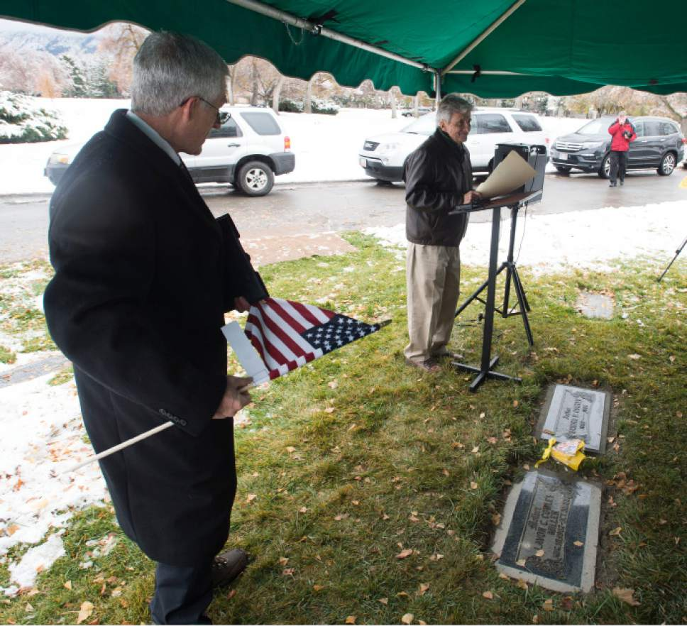 Steve Griffin / The Salt Lake Tribune   At the graveside of his parents, Lavon and Samuel Cowley, Sam Cowley tells about his father's life and eventual death as Special Agent for the FBI as the Utah Chapter of the Society of Former Special Agents of the FBI holds a memorial service for Cowley, who died Nov. 28, 1934, from wounds suffered in a gun battle with notorious bank robber Lester Gillis, known as Baby Face Nelson. Cowley was born in Idaho and received a degree from the Utah Agricultural College in Logan. Service was held at the Wasatch Lawn Memorial Park in Salt Lake City Monday November 28, 2016.