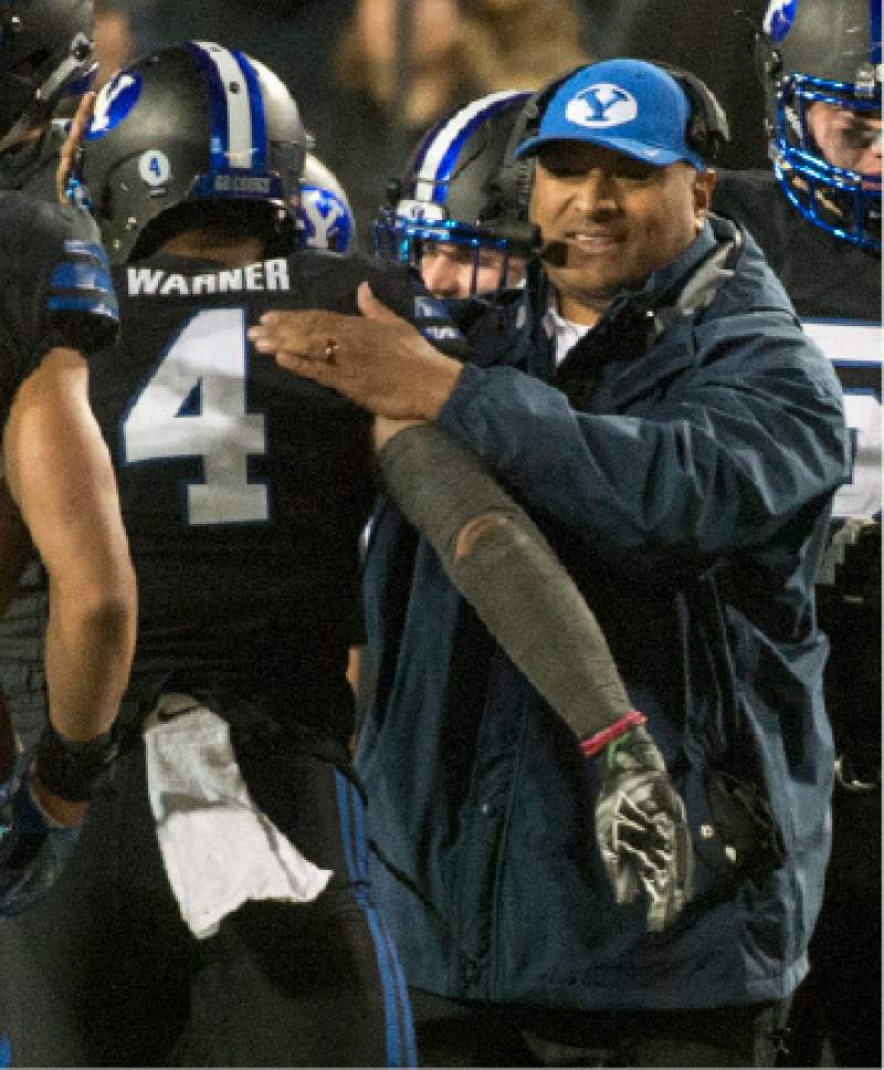 Rick Egan  |  The Salt Lake Tribune  Brigham Young Cougars head coach Kalani Sitake give Brigham Young Cougars linebacker Fred Warner (4) a pat on the shoulder, after he intercepted pass, in football action, BYU vs Utah State, at Lavell Edwards Stadium in Provo,  Saturday, November 26, 2016.