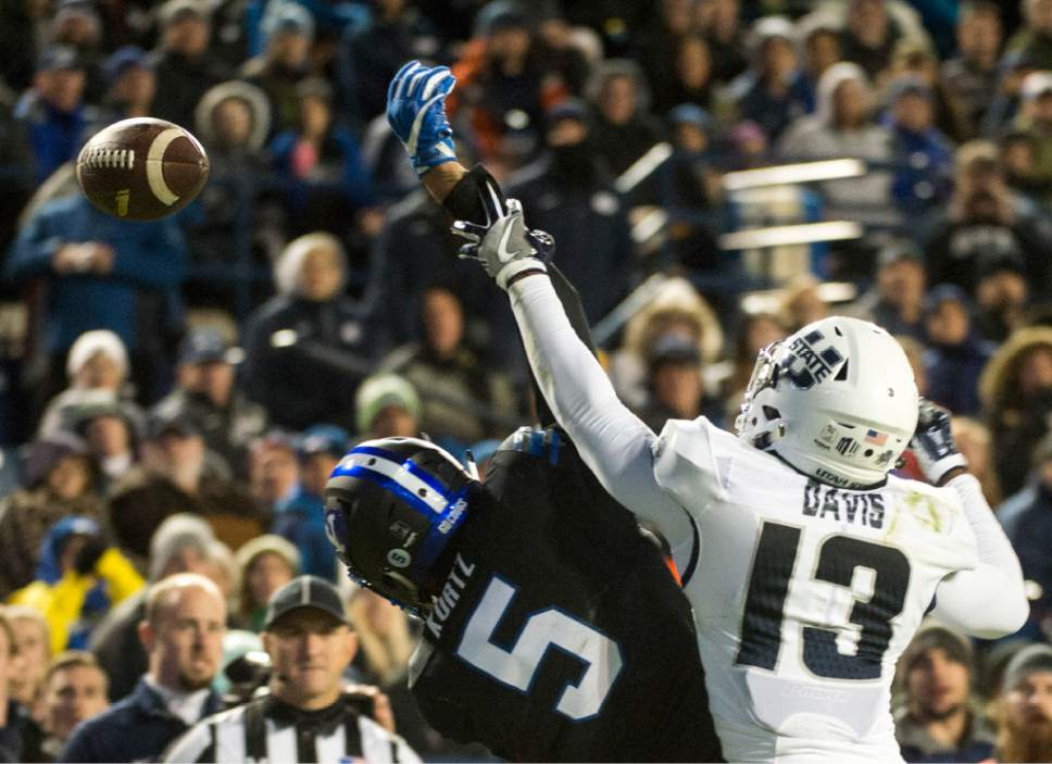 Rick Egan  |  The Salt Lake Tribune  Utah State Aggies cornerback Jalen Davis (13) is called for pass interference on the play as he collides with Brigham Young Cougars wide receiver Nick Kurtz (5), in football action, BYU vs Utah State, at Lavell Edwards Stadium in Provo,  Saturday, November 26, 2016.
