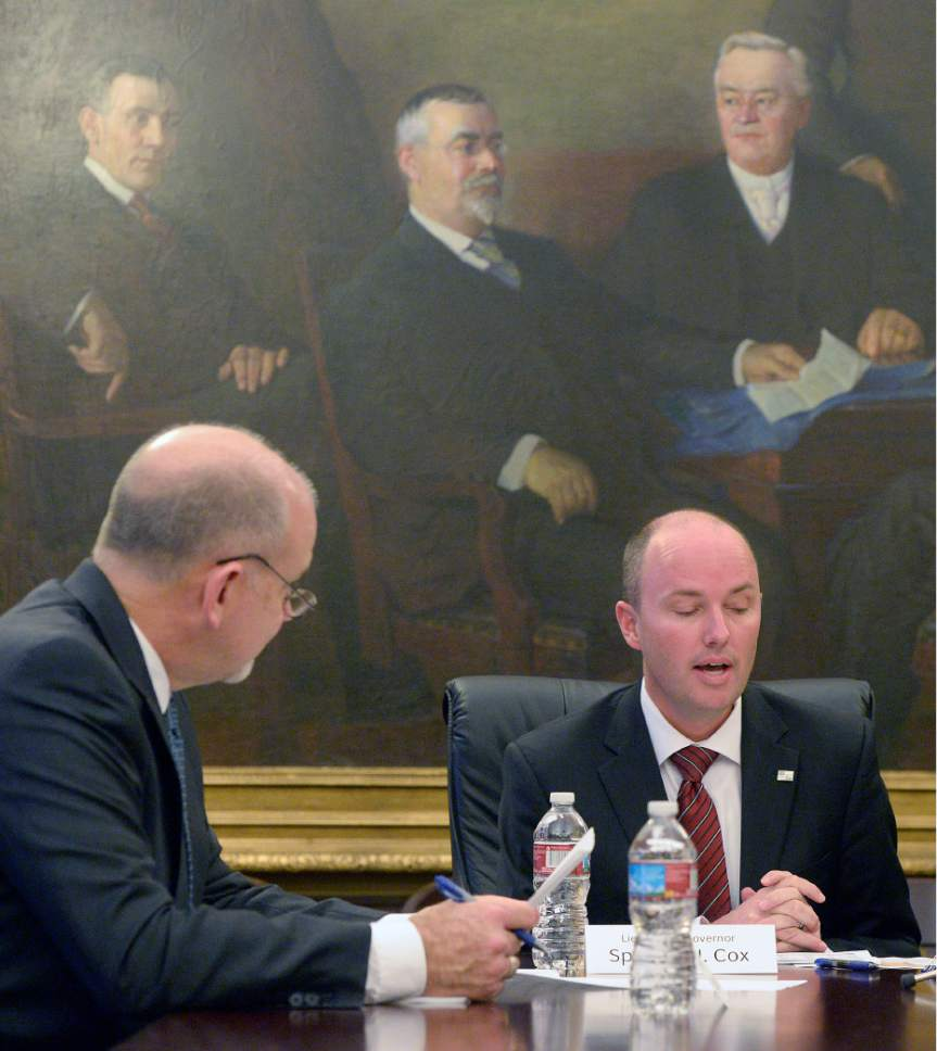 Al Hartmann  |  The Salt Lake Tribune State Treasurer David Damschen, left, and Lt. Governor Spencer Cox meet with the state board of canvassers to certify election results in the Capitol Board Room Monday Nov. 28.