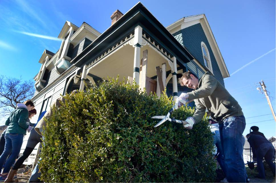 "Scott Sommerdorf   |  The Salt Lake Tribune   Volunteers doing landscaping and other work, surround the old Victorian home being renovated to house ""Encircle House"" which will be Provo's first LGBT resource center, Saturday November 19, 2016."