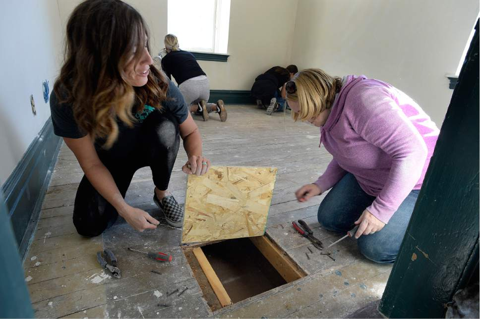 "Scott Sommerdorf   |  The Salt Lake Tribune   Brooke Lamont, left, and Erin Jiles work to renovate an upstairs floor during a work / cleanup day at the old Victorian home being renovated to house ""Encircle House"" which will be Provo's first LGBT resource center, Saturday November 19, 2016."