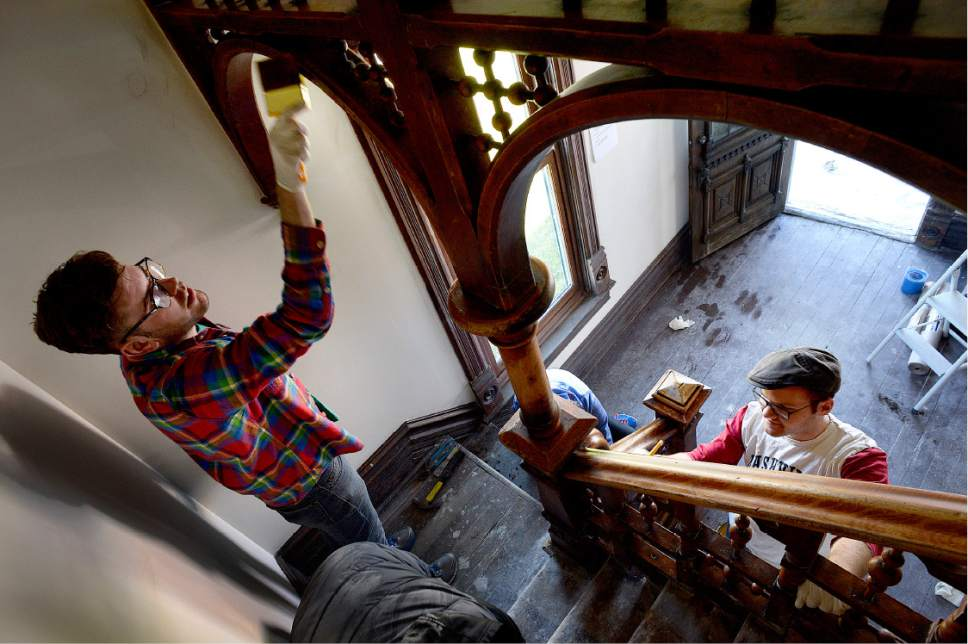 "Scott Sommerdorf   |  The Salt Lake Tribune   Volunteers work to restore the woodwork on an elaborate interior staircase during a work / cleanup day at the old Victorian home being renovated to house ""Encircle House"" which will be Provo's first LGBT resource center, Saturday November 19, 2016."