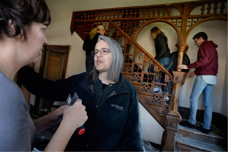 "Scott Sommerdorf   |  The Salt Lake Tribune   BYU law professor Kif Augustine, right, talks with Melissa Blackburn as they both volunteer during a work / cleanup day at the old Victorian home being renovated to house ""Encircle House"" which will be Provo's first LGBT resource center, Saturday November 19, 2016. More volunteers at right, head upstairs to help with work on the upstairs rooms."