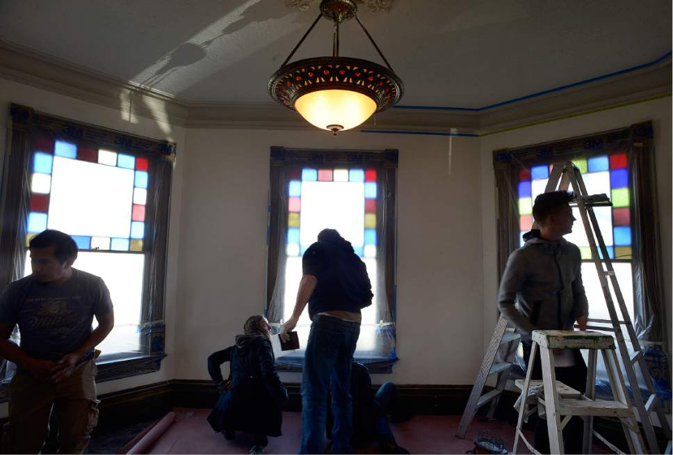 "Scott Sommerdorf   |  The Salt Lake Tribune   Volunteers prep the interior for painting during a work / cleanup day at the old Victorian home being renovated to house ""Encircle House"" which will be Provo's first LGBT resource center, Saturday November 19, 2016."