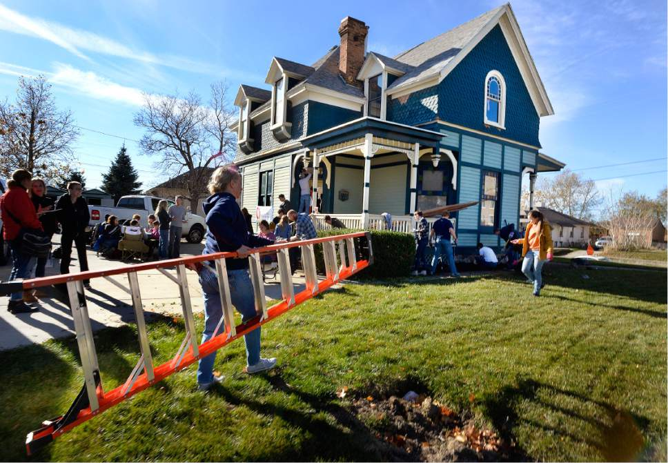 "Scott Sommerdorf   |  The Salt Lake Tribune   Volunteers arrive, and spring into in action during a work / cleanup day at the old Victorian home being renovated to house ""Encircle House"" which will be Provo's first LGBT resource center, Saturday November 19, 2016."