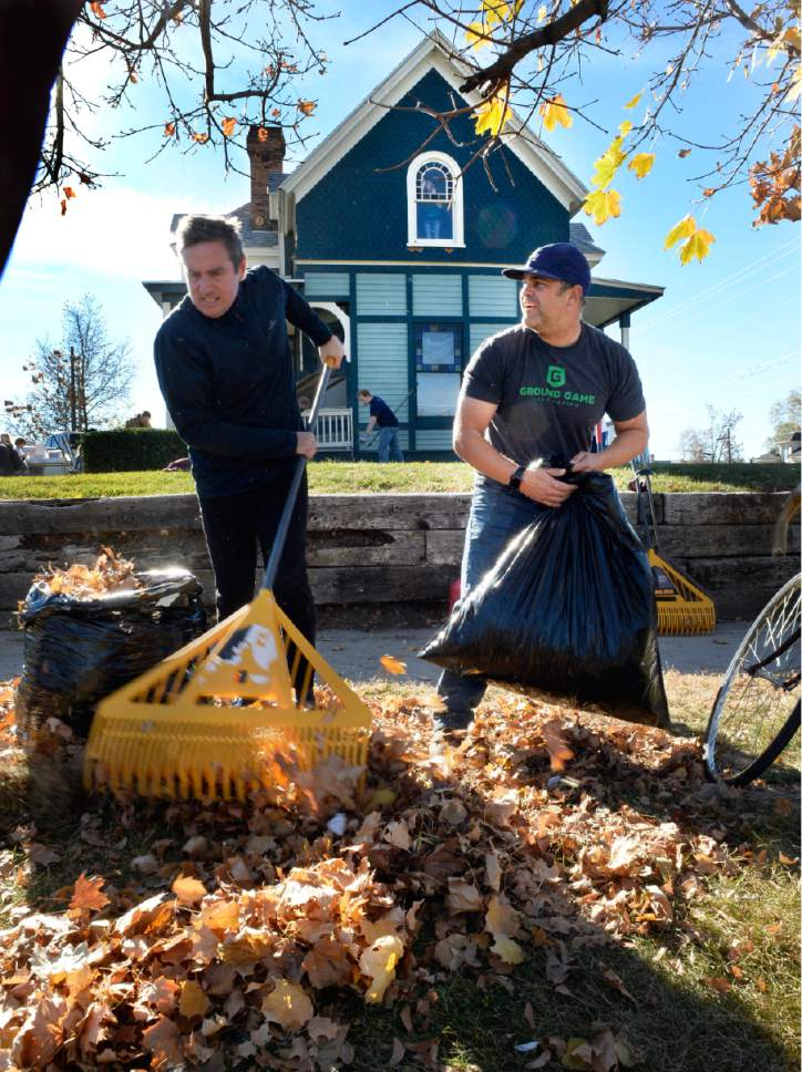 "Scott Sommerdorf   |  The Salt Lake Tribune   LDS bishop Monte MacGillivray, right, works with other volunteers to clean up leaves during a work / cleanup day at the old Victorian home being renovated to house ""Encircle House"" which will be Provo's first LGBT resource center, Saturday November 19, 2016."
