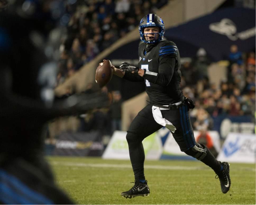 BYU quarterback Taysom Hill (7) looks to throw against Utah State during an NCAA college football game in Provo, Utah, Saturday, Nov. 26, 2016.  (Rick Egan/The Salt Lake Tribune via AP)