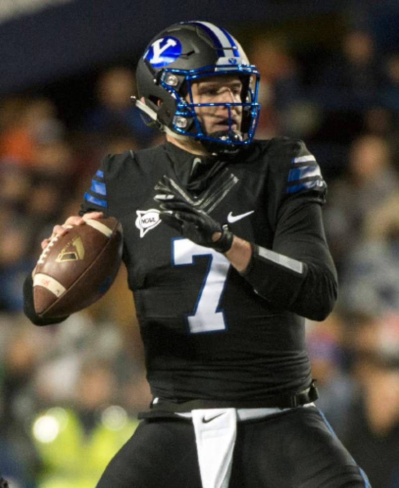 Rick Egan  |  The Salt Lake Tribune  Brigham Young quarterback Taysom Hill (7) looks to pass for the Cougars,  in football action, BYU vs Utah State, at Lavell Edwards Stadium in Provo,  Saturday, November 26, 2016.