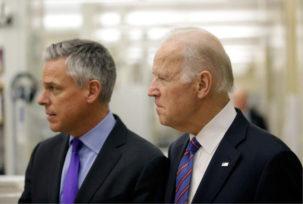 """Vice President Joe Biden walks with former Utah Gov. Jon M. Huntsman during a tour of the research lab at the Huntsman Cancer Institute Friday, Feb. 26, 2016, in Salt Lake City, as part of the White House's cancer """"moonshot,"""" an ambitious effort to double the rate of progress toward curing cancer and ramp up federally funded research on the disease. Working toward a cure for cancer is personal for Biden, whose 46-year-old son, former Delaware state Attorney General Beau Biden, died from brain cancer in May. (AP Photo/Rick Bowmer, Pool)"""