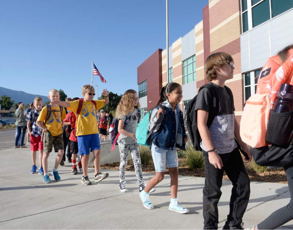 Al Hartmann  |  The Salt Lake Tribune Students line up by classroom and march together to enter the brand new Butler Elementary in Cottonwood Heights on Aug. 25, 2016.