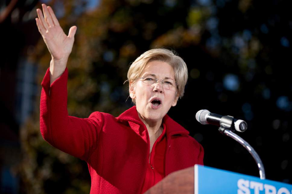 """FILE - In this Oct. 24, 2016, file photo, Sen. Elizabeth Warren, D-Mass. speaks at a rally for Democratic presidential candidate Hillary Clinton at St. Anselm College in Manchester, N.H. Warren says a bill providing extra money for medical research is """"extortion"""" and a giveaway to big biomedical companies. She also said the bill benefits a Republican donor who backs controversial therapies that are supposed to regenerate cells. (AP Photo/Andrew Harnik, file)"""