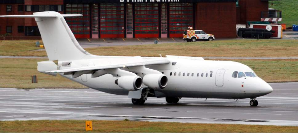 FILE - This is a Nov. 11, 2012 file photo taken at Birmingham Airport in central England of a BAE 146 aircraft  similar to the one which has crashed in Colombia  Tuesday Nov. 29, 2016. Colombian officials say that a chartered plane carrying a Brazilian first division soccer team has crashed near Medellin while on its way to the finals of a regional tournament. The British Aerospace 146 short-haul plane,  was operated by a charter airline named LaMia.   (David Jones/PA File via AP)