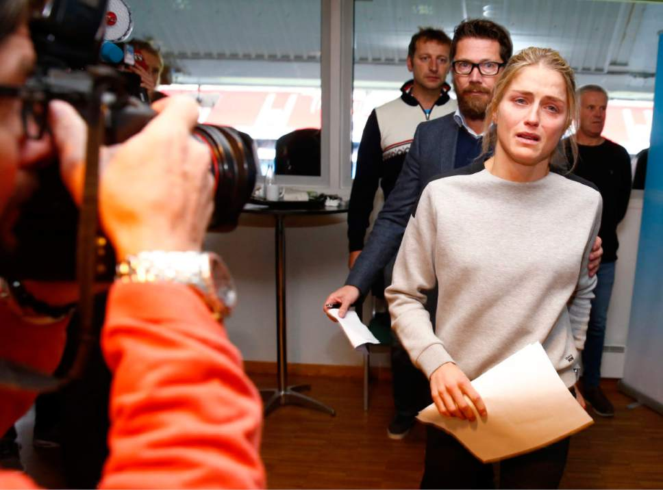 FILE - In this Thursday, Oct. 13, 2016 file photo, Norwegian three-time Olympic cross-country skiing medalist Therese Johaug, right, arrives for press conference in Oslo.  Norway's anti-doping agency  tuesday Nov. 29, 2016, has called for a 14-month doping ban for cross-country star Therese Johaug after she tested positive for a steroid she said she took unknowingly.  (Hakon Mosvold Larsen/ NTB scanpix via AP, File)