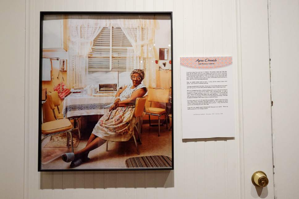 "Francisco Kjolseth | The Salt Lake Tribune The Park City Museum hosts the ""Apron Chronicles: A Patchwork of American Recollections."" Pictured is Ada Florence Ashford, 1909-2005, one of many portraits depicted with their apron stories."