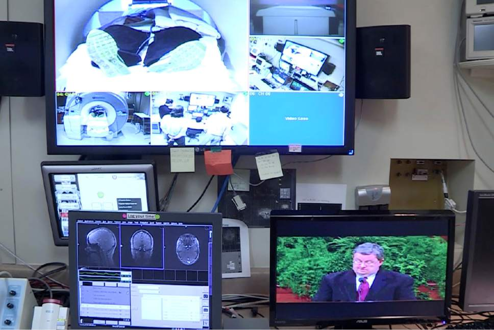 Courtesy photo Control panel monitors show participants in the MRI (top), brain scans (lower left), and religious imagery shown to study participants (lower right).