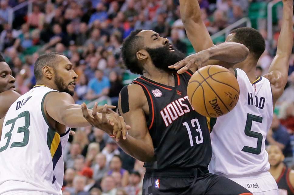 Utah Jazz center Boris Diaw (33) fouls Houston Rockets guard James Harden (13) as he drives to the basket in the first half of an NBA basketball game Tuesday, Nov. 29, 2016, in Salt Lake City. (AP Photo/Rick Bowmer)