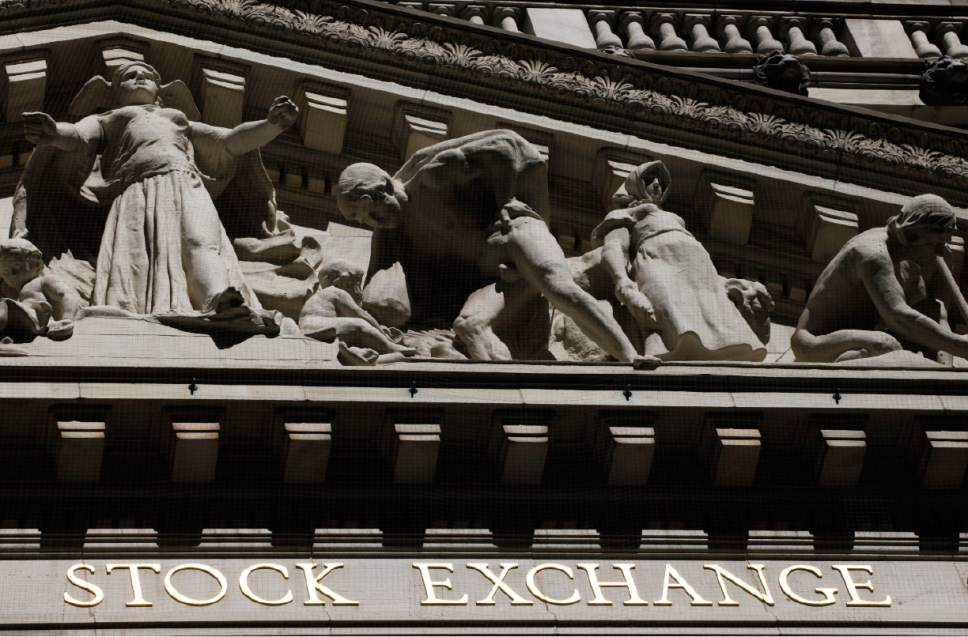 FILE - This July 15, 2013, file photo, shows the New York Stock Exchange. Oil prices surged Wednesday, Nov. 30, 2016, on expectations of a production cut from the OPEC cartel of producers. Shares in oil companies rose in the slipstream of higher oil prices, helping indexes around the world to post solid gains. (AP Photo/Mark Lennihan, File)