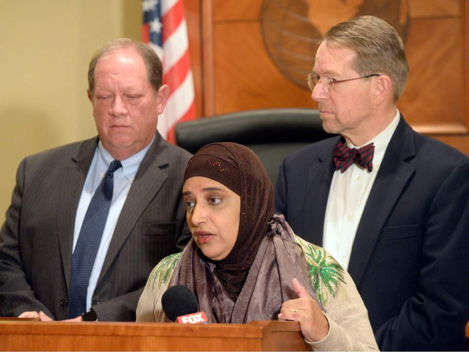 Al Hartmann  |  The Salt Lake Tribune Attorneys Brad Parker, left back, and James McConkie join Noor Ul-Hasan, a Muslim community leader, to announce that a diverse, nonpartisan group of attorneys and other professionals from around the state have formed the Refugee Justice League of Utah. The new organization is dedicated to promoting and defending the civil, religious, and constitutional rights of persons who are discriminated against on the basis of their religious beliefs and national origins.