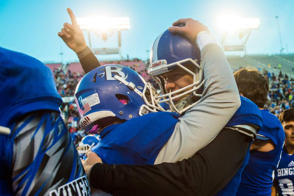 Chris Detrick  |  The Salt Lake Tribune Bingham's Hunter Allred (29) and Bingham's Dylan Gibson (12) celebrate after winning the 5A football championship at Rice-Eccles Stadium Friday November 18, 2016. Bingham defeated Lone Peak 17-10.