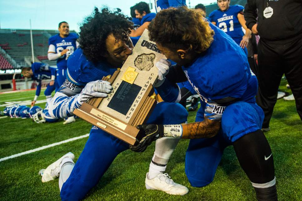 Chris Detrick  |  The Salt Lake Tribune Bingham's Tevita Tuifua (49) and Bingham's Malachi Fotu (45) celebrate after winning the 5A football championship at Rice-Eccles Stadium Friday November 18, 2016. Bingham defeated Lone Peak 17-10.