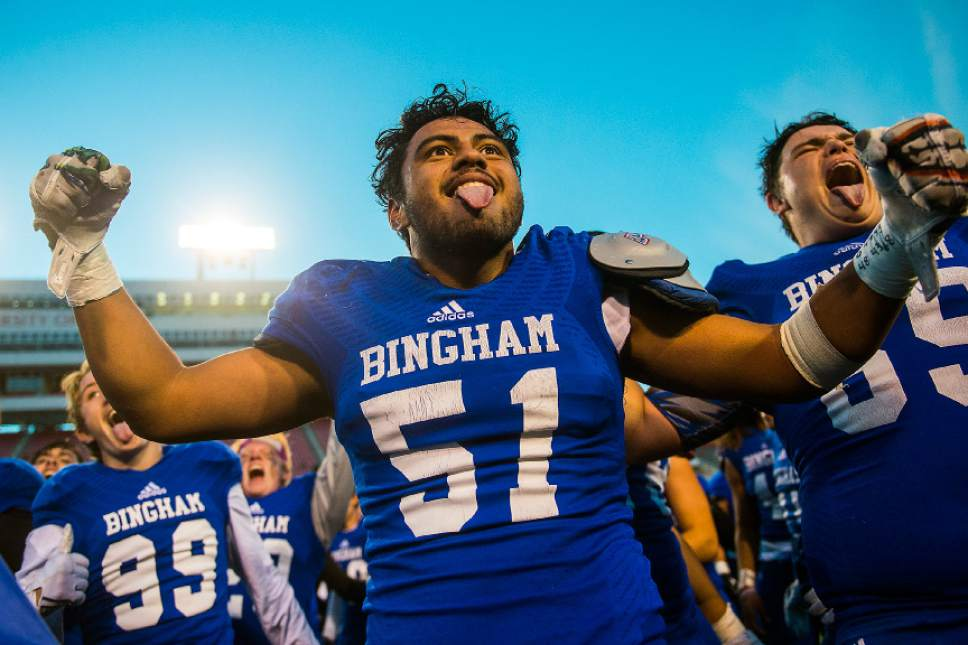 Chris Detrick  |  The Salt Lake Tribune Bingham's Brigham Tuatagaloa (51) andBingham's Tavian Myers (69) celebrate after winning the 5A football championship at Rice-Eccles Stadium Friday November 18, 2016. Bingham defeated Lone Peak 17-10.