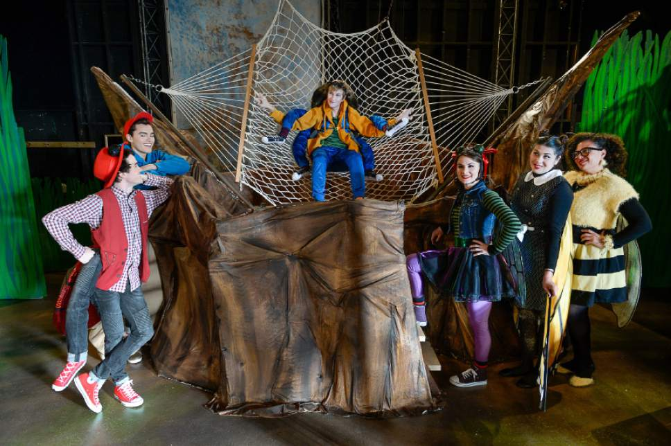 "Francisco Kjolseth | The Salt Lake Tribune SLAC's annual holiday children's show brings to life the ""Diary of a Worm, a Spider and a Fly."" Featured from left, Joseph Paul Branca, Sky Kawai, Cameron Fleck, Emilie Starr, Micki Martinez and Alicia M. Washington, gather around the spider web."