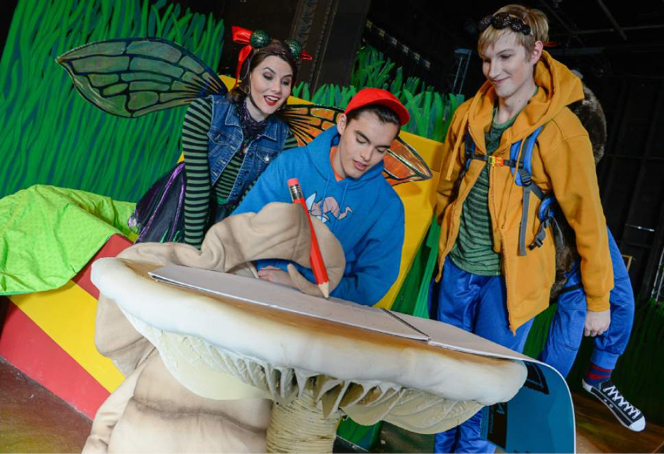 "Francisco Kjolseth | The Salt Lake Tribune SLAC's annual holiday children's show brings to life the ""Diary of a Worm, a Spider and a Fly.""  Gathered around the mushroom table, from left, Fly, Emilie Starr; Worm, Sky Kawai and Spider, Cameron Fleck."