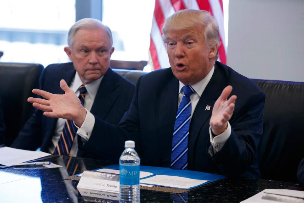 FILE - In this Oct. 7, 2016 file photo, Sen. Jeff Sessions, R-Ala. listens at left as then-Republican presidential candidate Donald Trump speaks during a national security meeting with advisers at Trump Tower in New York. As one of President-elect Donald Trump's closest and most consistent allies, Sessions is a likely pick for a top post in his administration. But the last time Sessions faced Senate confirmation it didn't go well. (AP Photo/ Evan Vucci, File)