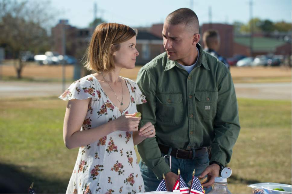 "This image released by Lionsgate shows Kate Mara, left, and Shia LaBeouf in a scene from, ""Man Down."" (Lionsgate via AP)"