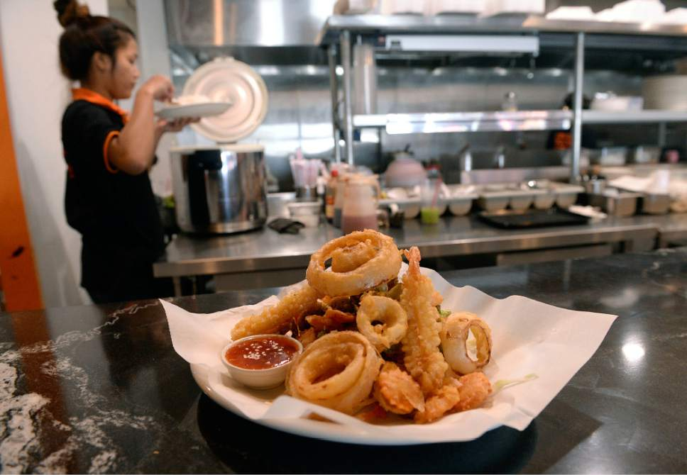 Al Hartmann  |  The Salt Lake Tribune Shrimp tempura with onion rings, broccoli, carrots, mushrooms, with a sweet and sour sauce at Zabb Noodles in South Salt Lake.