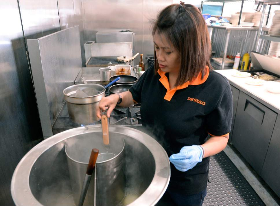 Al Hartmann  |  The Salt Lake Tribune Maneerat Chitratonn, owner of Zabb Noodles in South Salt Lake, steams noodles in broth for a build-your-own Zabb Noodles Soup.