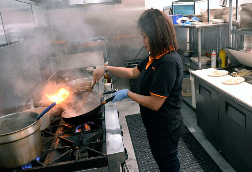 Al Hartmann  |  The Salt Lake Tribune Maneerat Chitratonn, owner of Zabb Noodles in South Salt Lake, flash-frys pork for an order of  Zabb Noodles soup.