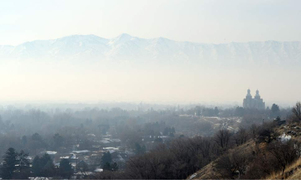 Keith Johnson | The Salt Lake Tribune  The Logan, Utah LDS temple sits under a shroud of inversion, December 18, 2013.